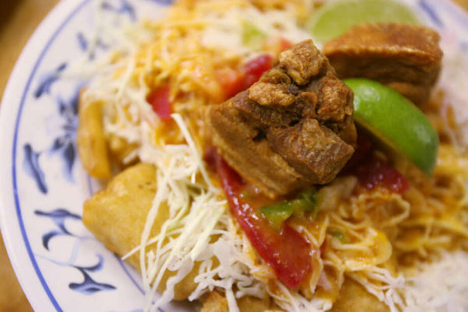 Fried yucca with pork is a signature dish at Las Hamacas Restaurante, local chain of Honduran restaurants. Photo: Mayra Beltran, Houston Chronicle