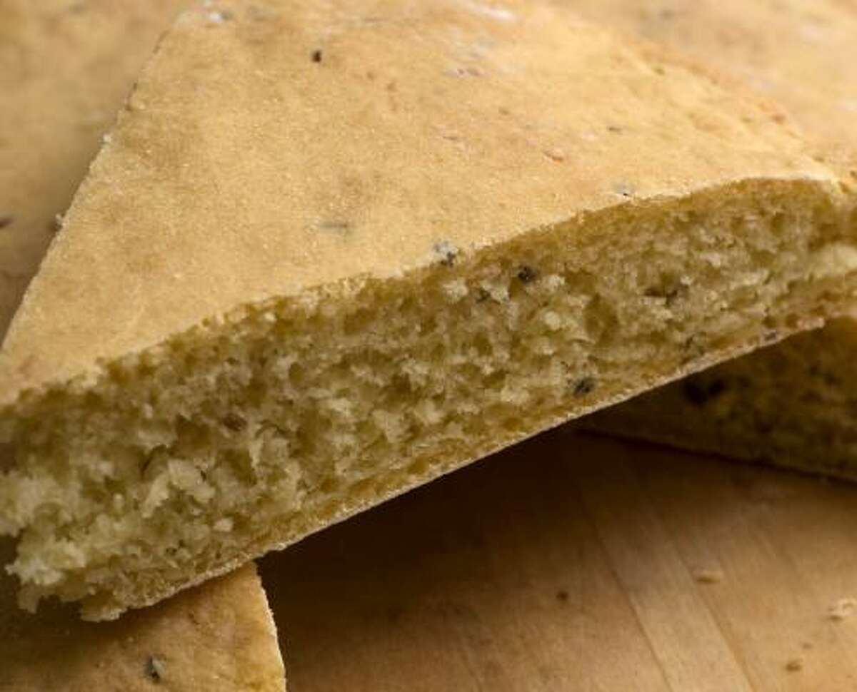 This fragrant, yeasted flatbread from Morocco is studded with aniseed and sesame seeds.
