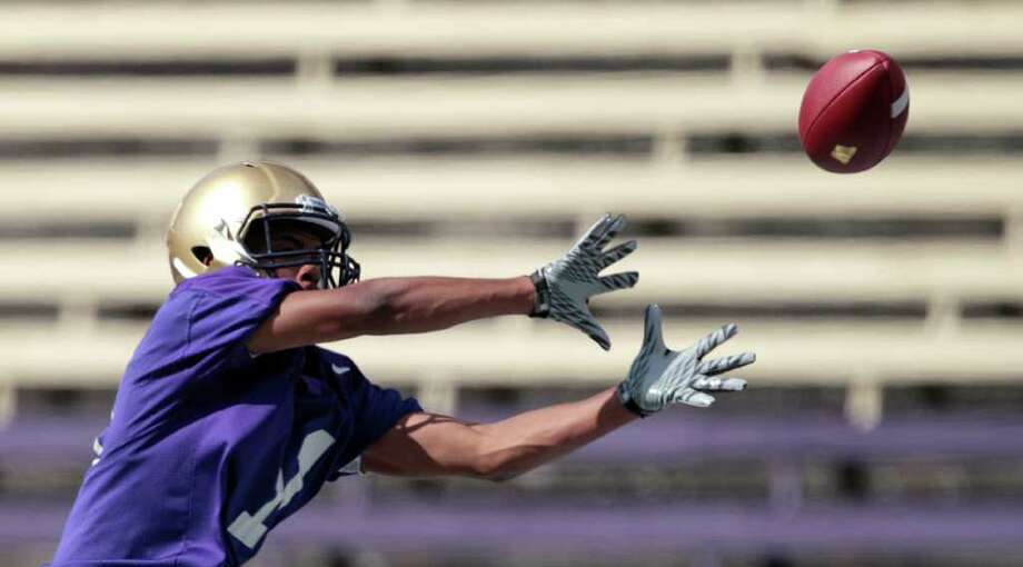 Washington's Jamaal Jones reaches for a pass during the NCAA college football team's first practice of the season Monday, Aug. 8, 2011, in Seattle. Photo: (AP Photo/Elaine Thompson)