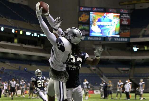Cowboys wide receiver Jesse Holley snags the ball in the end zone with Chris Randle (33) in pursuit during training camp at the Alamodome on Monday, Aug. 8, 2011. The Cowboys have a preseason game in Dallas on Thursday against the Denver Broncos. Photo: John Davenport/jdavenport@express-news.net