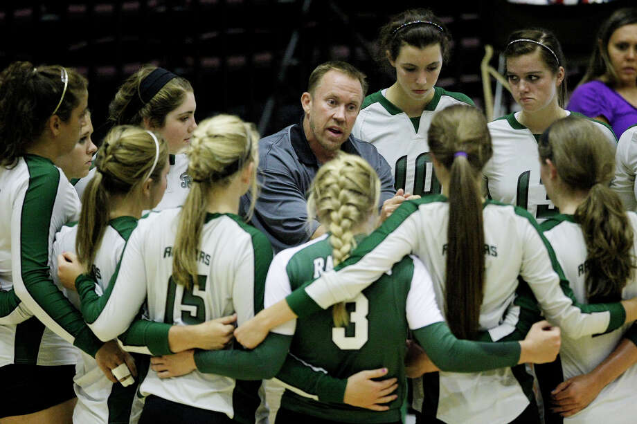 Reagan coach Mike Carter instructs his team during his 600th career victory Monday, Aug. 8, 2011. Carter is the fourth local coach to reach the plateau. Photo: Darren Abate/Special To The Express-News