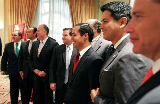 Mayor Julian Castro (center) poses for a photo with members of the San Antonio Hispanic Chamber of Commerce after a press conference held at the Four Seasons Hotel  Monday Aug. 8, 2011 in Mexico City, Mexico. Photo: EDWARD A. ORNELAS, Edward A. Ornelas/Express-News / © SAN ANTONIO EXPRESS-NEWS (NFS)