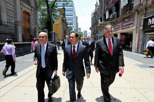 Consul General of Mexico in San Antonio Armando Ortiz Rocha (from left) Mayor Julian Castro, and Councilman Ray Lopez walk to a lunch at the Bankers' Club of Mexico Monday Aug. 8, 2011 in the Centro Historico neighborhood of Mexico City, Mexico. Photo: EDWARD A. ORNELAS, Edward A. Ornelas/Express-News / © SAN ANTONIO EXPRESS-NEWS (NFS)