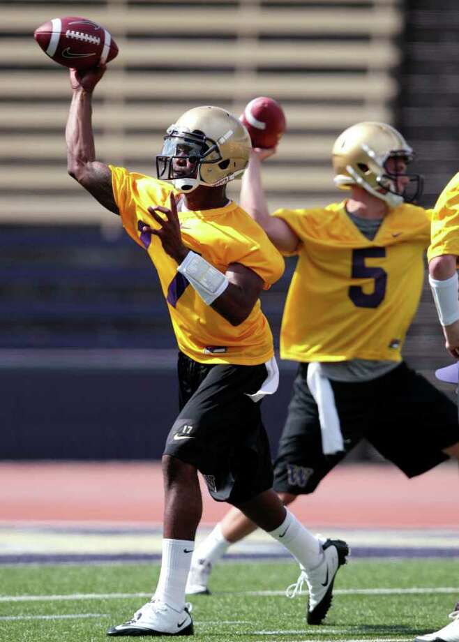 Washington quarterbacks Keith Price, left, and Nick Montana throw during NCAA college football practice Monday, Aug. 8, 2011, in Seattle. Photo: (AP Photo/Elaine Thompson)