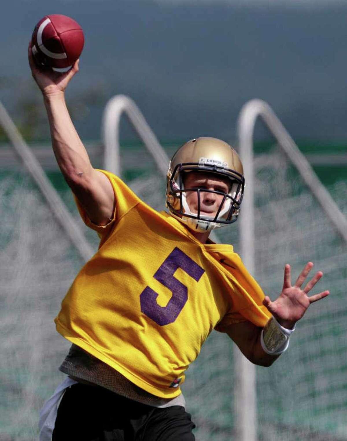 Washington quarterback Nick Montana throws during the NCAA college football team's first practice of the season, Monday, Aug. 8, 2011, in Seattle. (AP Photo/Elaine Thompson)