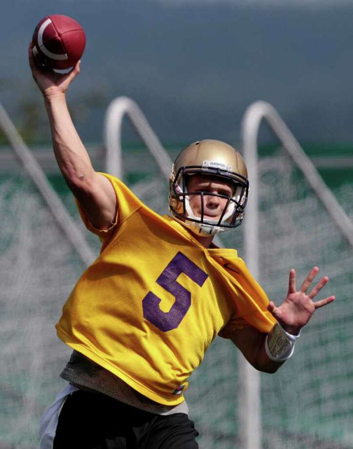 Washington quarterback Nick Montana throws during the NCAA college football team's first practice of the season, Monday, Aug. 8, 2011, in Seattle. (AP Photo/Elaine Thompson) Photo:  (AP Photo/Elaine Thompson)