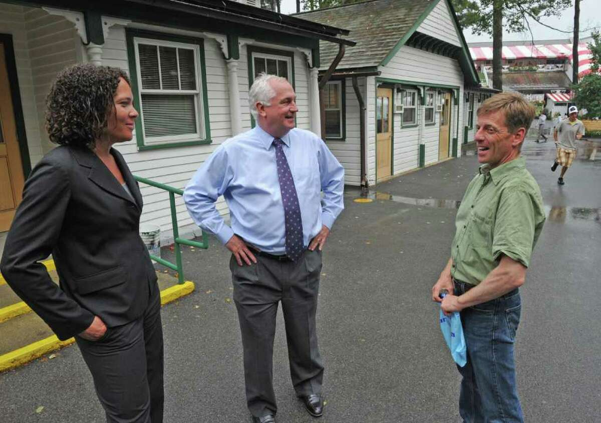Ellen McClain, Senior VP and CFO of NYRA, left speaks with Charlie Hayward, President and CEO of NYRA, center and former jockey and now spokesman for NYRA Richard Migliore at the Saratoga Race Course in Saratoga Springs, N.Y. Aug. 8, 2011. (Skip Dickstein / Times Union)