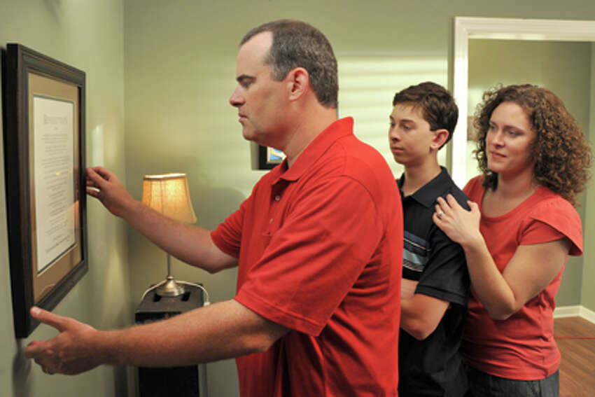 (L-R) Alex Kendrick as Adam Mitchell, Rusty Martin as Dylan Mitchell and Renee Jewell as Victoria Mitchell in