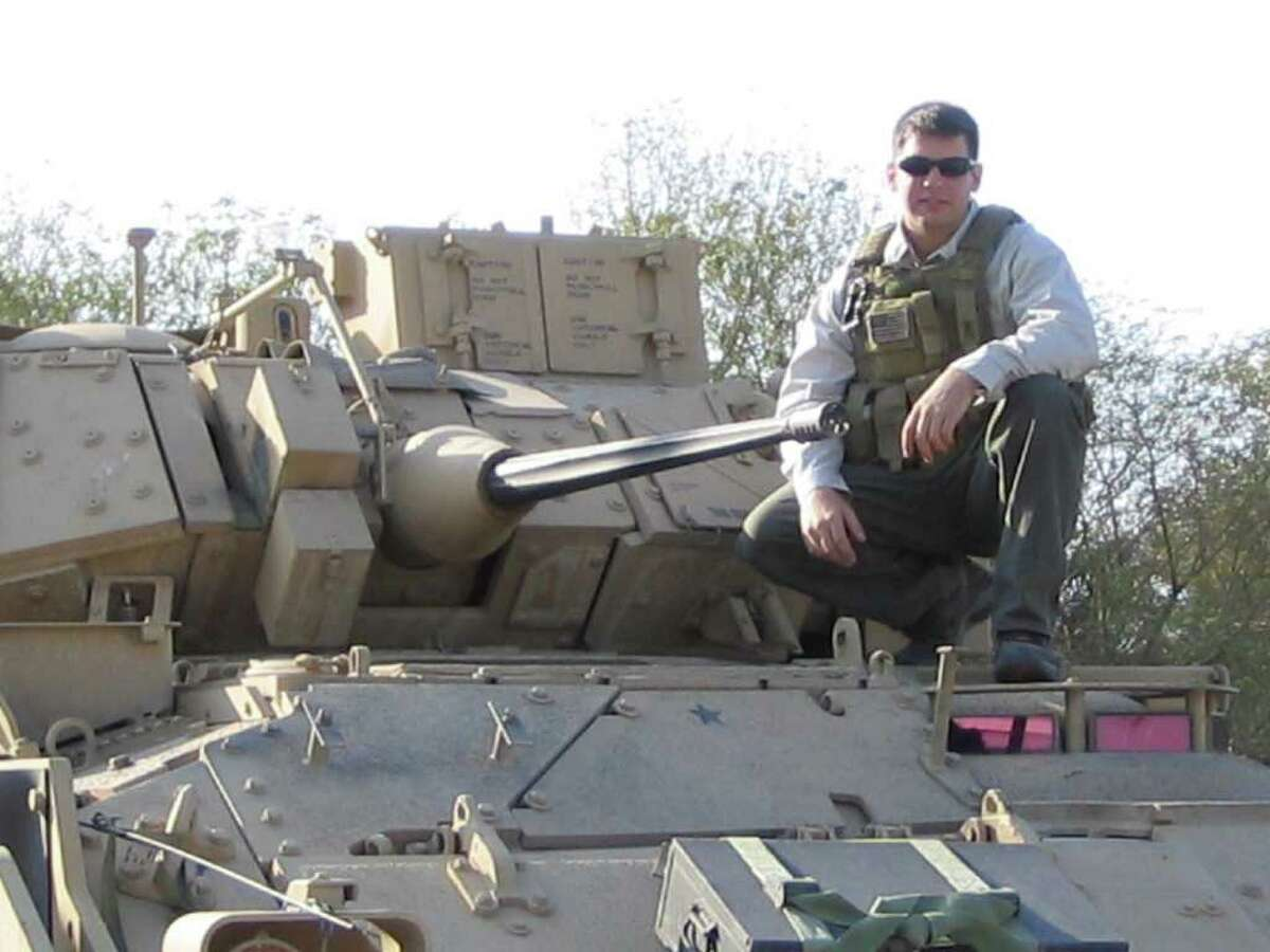 Navy SEAL Brian Bill on a Bradley Fighting Vehicle in 2004.