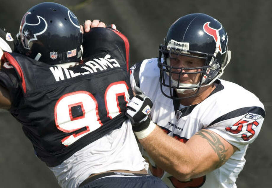 Texans center Chris Myers (55) blocks DE Mario Williams (90) during Texans training camp Monday. Myers is used to facing players bigger than he is. Photo: Brett Coomer, Houston Chronicle