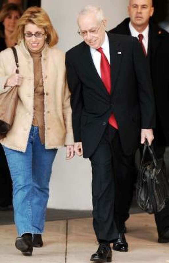 Attorney General Michael Mukasey, with his wife Susan, leaves George Washington University Hospital on Friday. Photo: KEVIN WOLF, ASSOCIATED PRESS
