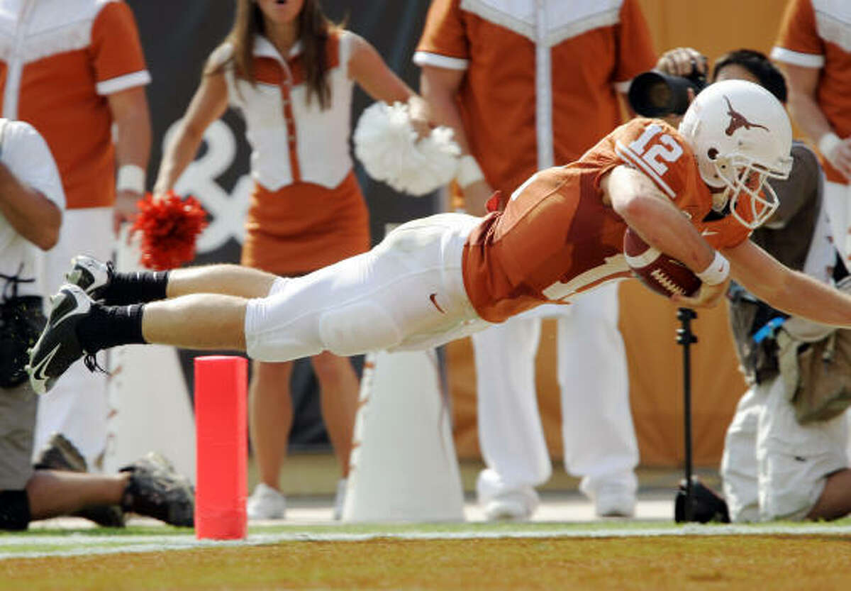 Colt McCoy soars into the end zone on a 35-yard touchdown in the second quarter Saturday.