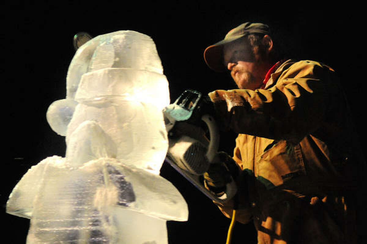 Ice artist Jay Maclaskey works on an ice sculpture during the 8th Annual Ice Cutters Christmas at his Silver Star Ranch in Montgomery.