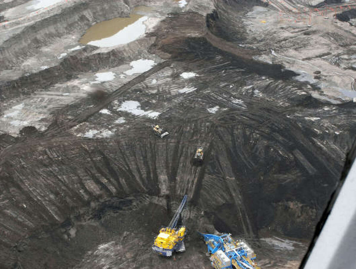 Some companies are delaying decisions to move forward with projects in Canada's challenging oil sands as lower oil prices threaten the profitability of high-cost production there.