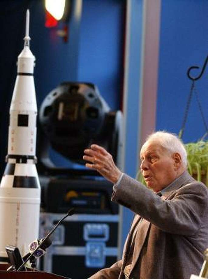 Konrad Dannenberg speaks at a ceremony Tuesday. Behind him is a Saturn V rocket, which Wernher von Braun's team helped design. Photo: DAVE DIETER, NEWHOUSE