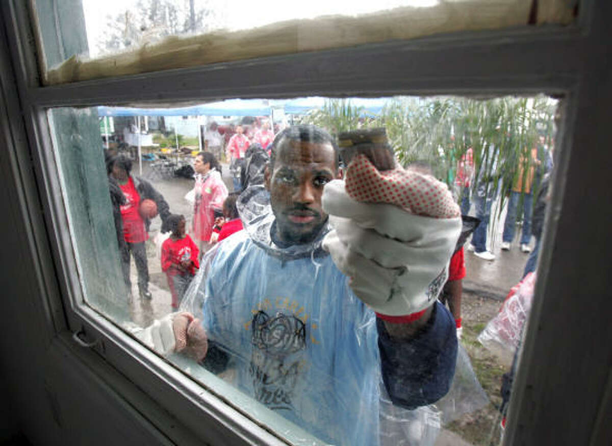 LeBron James works on a house in New Orleans' Holy Cross neighborhood.