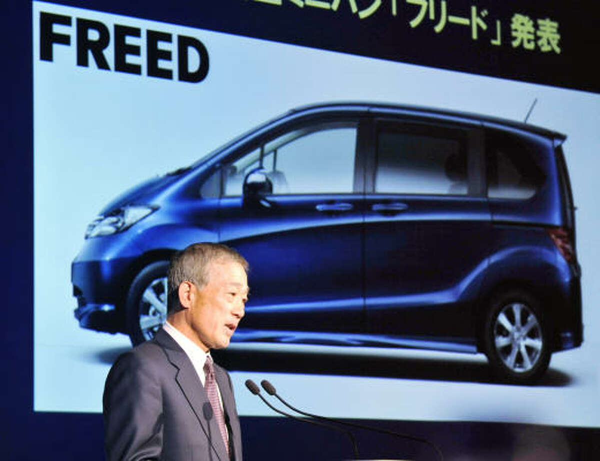 Japan's auto giant Honda Motor president Takeo Fukui speaks during a press conference at the company's headquarters in Tokyo today. Fukui said the company will release a new hybrid vehicle in 2009 in the market, aiming to sell 200,000 units a year.