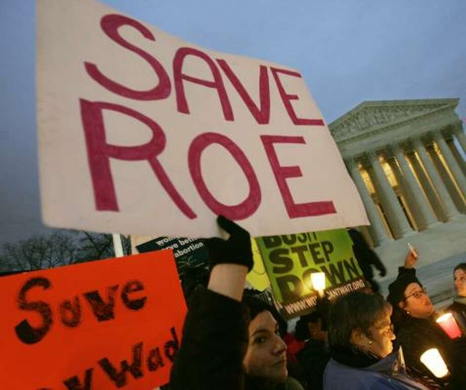 Abortion-rights supporters held a vigil at the Supreme Court building in 2005 to mark the anniversary of the Roe v. Wade decision. Photo: PABLO MARTINEZ, ASSOCIATED PRESS