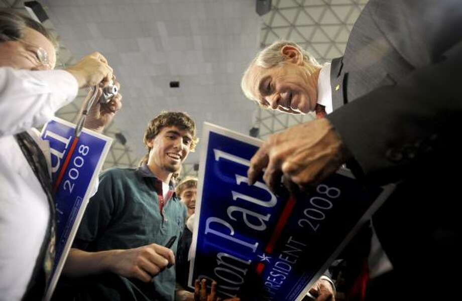 U.S. Rep. Ron Paul meets students and supporters following a convocation at Liberty University. About 8,500 showed up for Friday's event in Lynchburg, Va., the largest he has seen on the campaign trail. Photo: JILL NANCE, THE NEWS AND ADVANCE