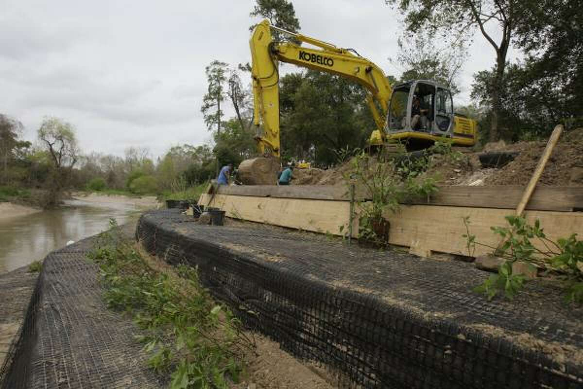 Terri Thomas hired contractors to build a wall to stem erosion at her Memorial Park-area home on Buffalo Bayou.