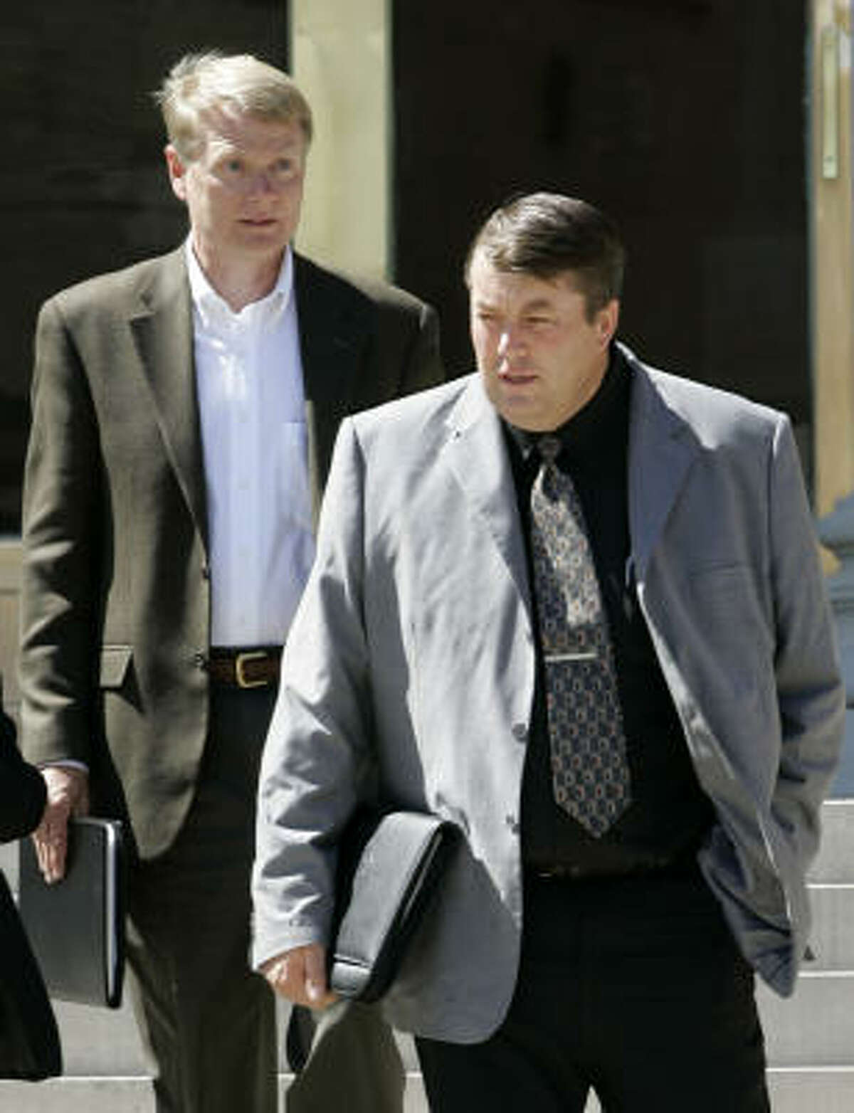 Willie Jessop, right, a leader in the Fundamentalist Church of Jesus Christ of Latter Day Saints, leaves the courthouse in San Angelo last month with Rod Parker, an FLDS spokesman.