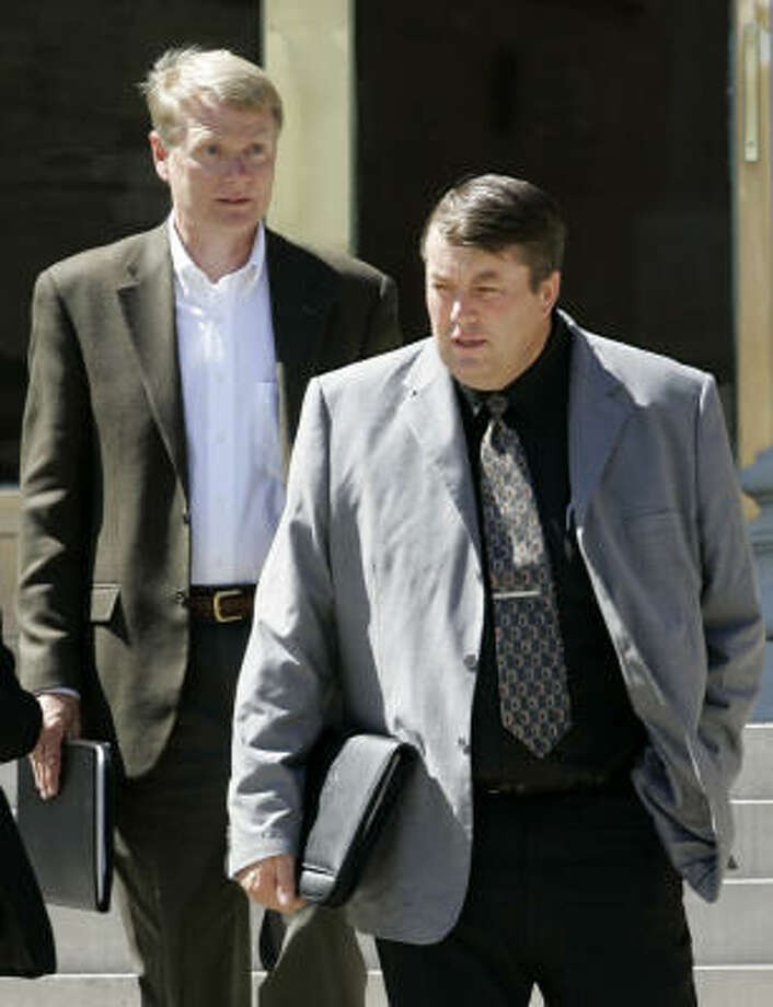 Willie Jessop, right, a leader in the Fundamentalist Church of Jesus Christ of Latter Day Saints, leaves the courthouse in San Angelo last month with Rod Parker, an FLDS spokesman. Photo: Tony Gutierrez, AP