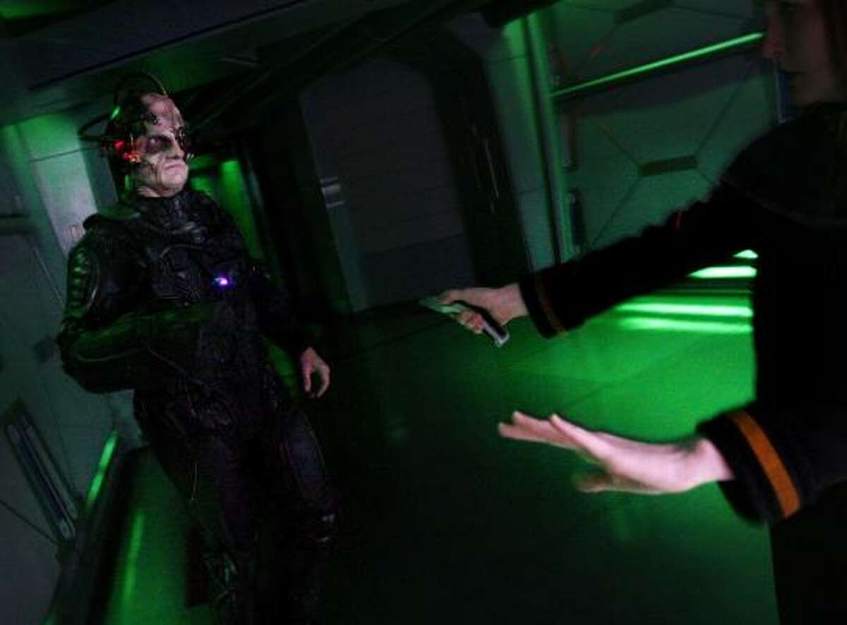 Actors perform as a Borg and Starfleet officer in Star Trek: The Experience.