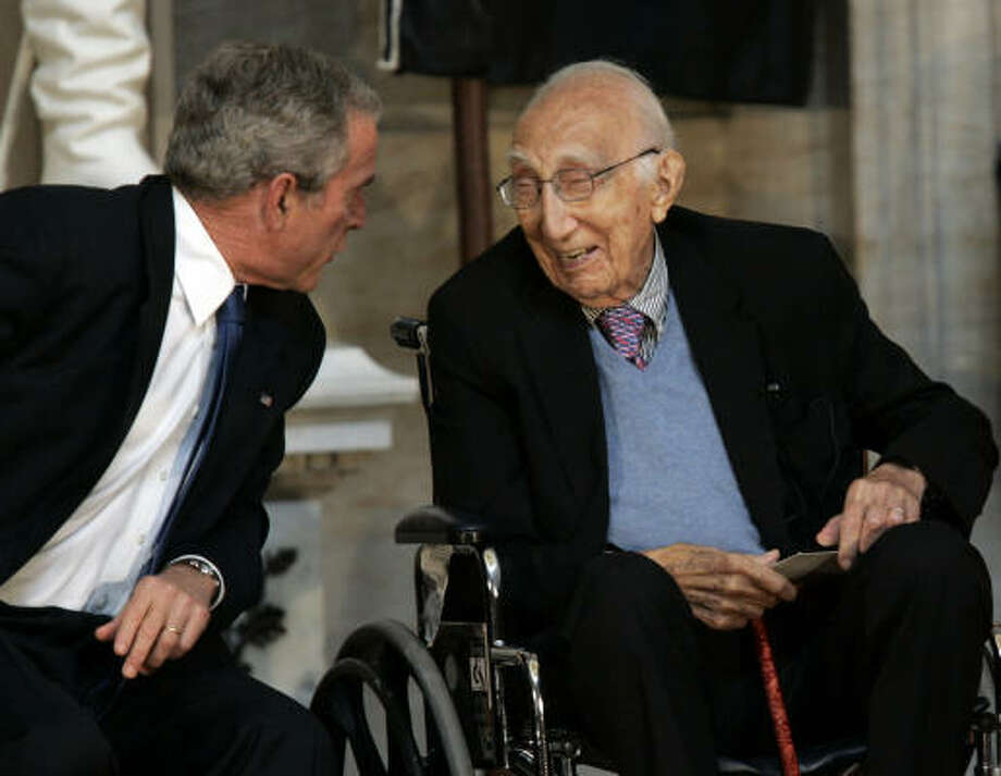 President Bush talks with renowned heart surgeon Dr. Michael DeBakey of Houston as he received the Congressional Gold Medal today at a ceremony in the Capitol Rotunda in Washington. Photo: Susan Walsh, AP