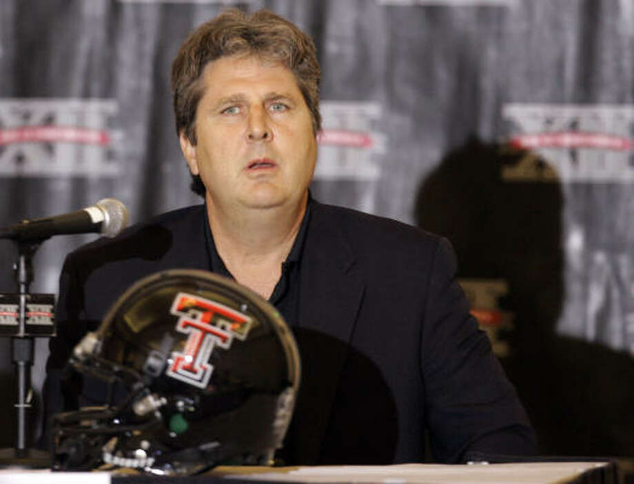 Texas Tech coach Mike Leach listens to a reporters question during Big 12 Media. Photo: Orlin Wagner, AP