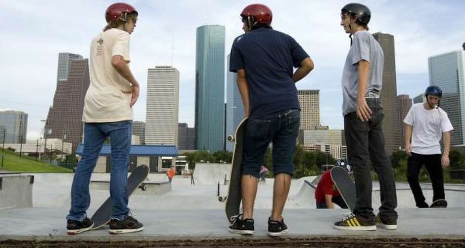 While skateboarders wait their turn at the Lee and Joe Jamail Skatepark, loft residents are voicing complaints to city officials. Photo: BRETT COOMER, CHRONICLE