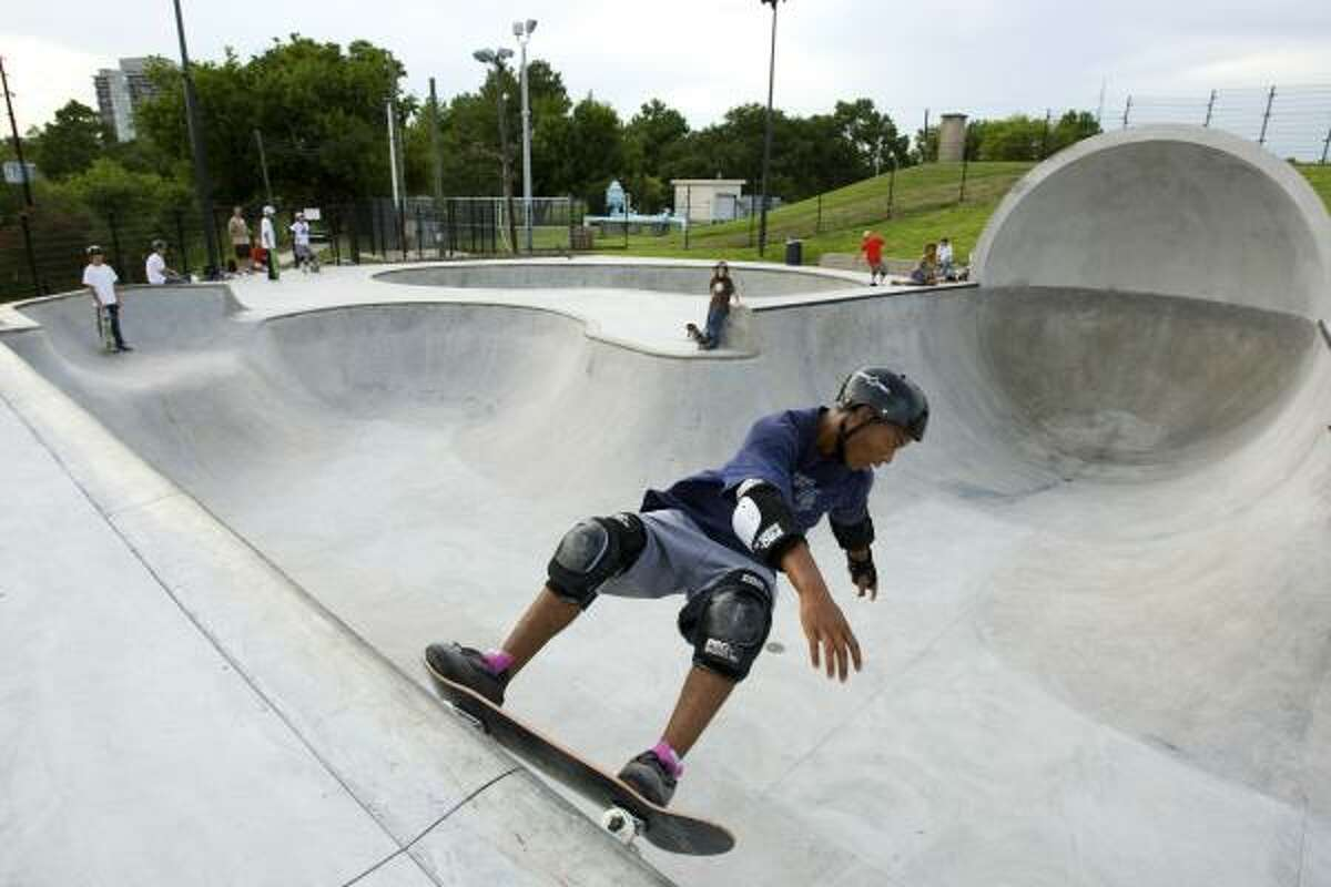 Lawrence Putman, 15, rides on the edge of a ramp at the Lee and Joe Jamail Skatepark. Sabine Street Loft residents claim skateboarders are leaving trash, parking illegally and tagging city property.