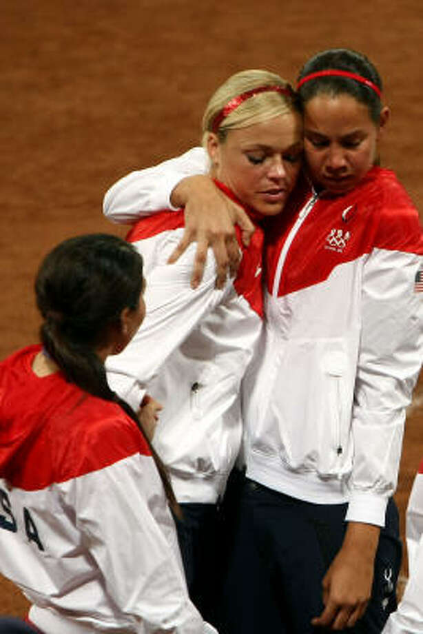 Jennie Finch, center and Cat Osterman, right,console each other after the U.S. fell 3-1 to Japan in the women's gold medal game at Fengtai Softball Field on Thursday. Photo: Jonathan Ferrey, Getty Images