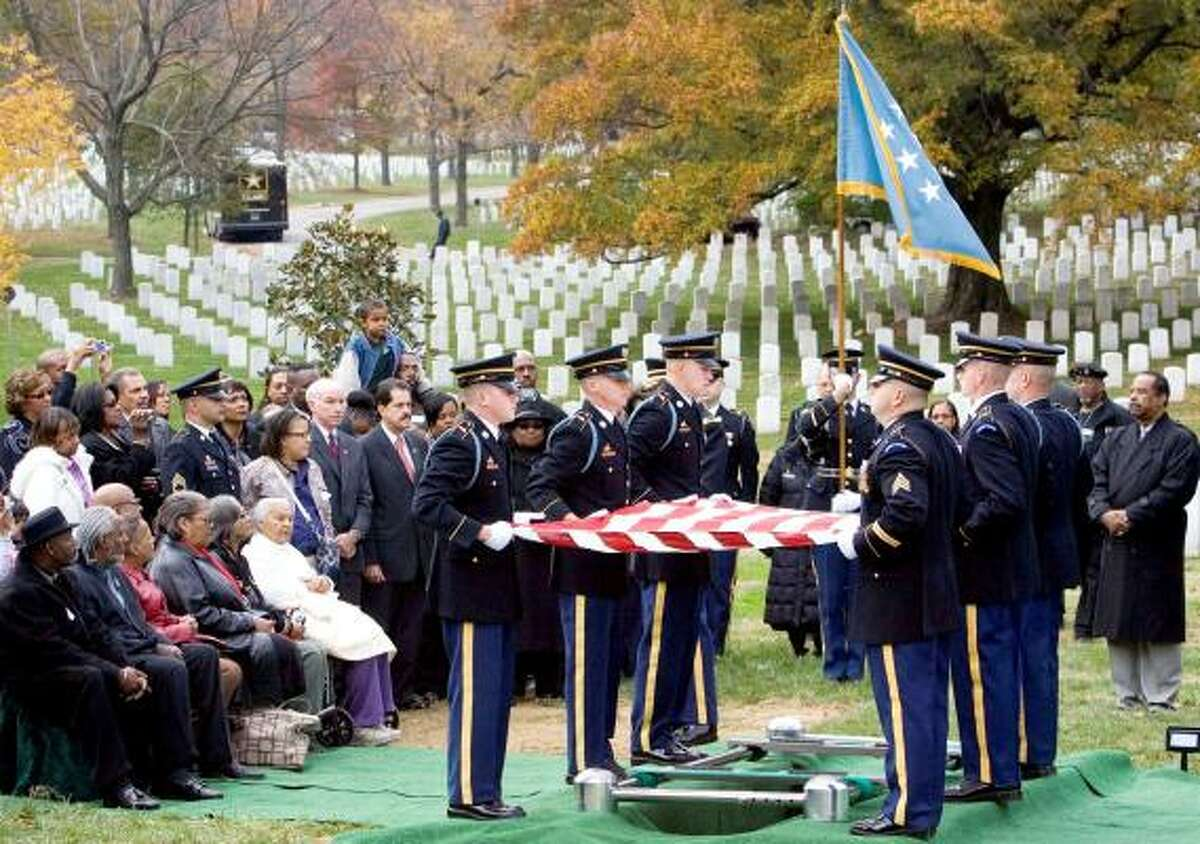 Family members, relatives, friends and members of the 24th Infantry Regiment, 25th Infantry Division, nicknamed the Buffalo Soldiers, attend a memorial ceremony in honor of Medal of Honor recipient Army Sgt. Cornelius Charlton, at Arlington National Cemetery in Arlington, Va.