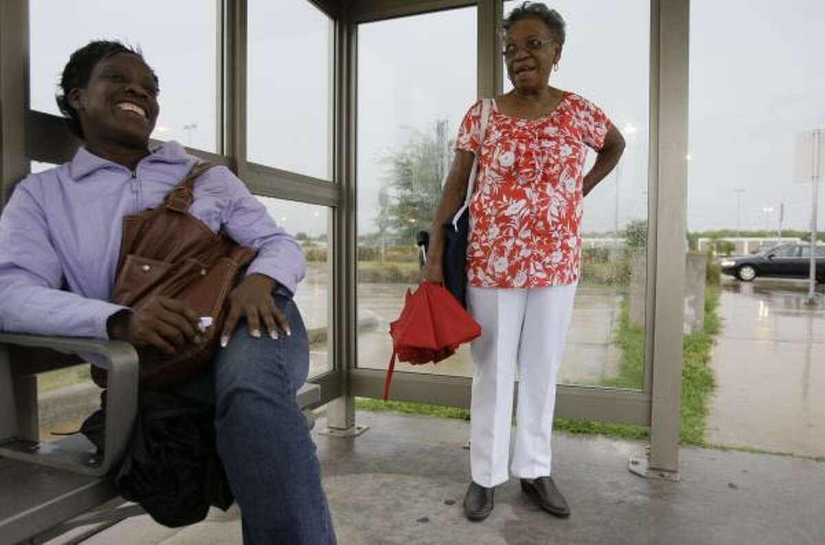 Angina Lewis, left, and Margaret Jenkins talk as Jenkins waits for the third of her four bus transfers.