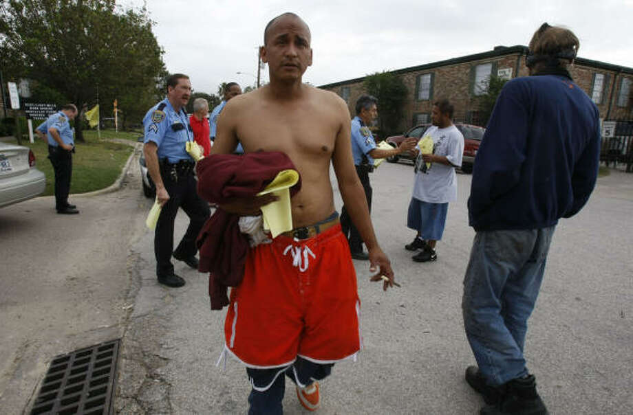 """I have to move? I just paid my rent,"" said Rafael Renteria as he is seen after talking with HPD officers at La Casita Apartments on Thursday. HPD Sgt. Frank Escobedo said the officers were trying to keep control and said that management had told residents the water and power would be shut down in their apartments. Photo: Julio Cortez, Chronicle"