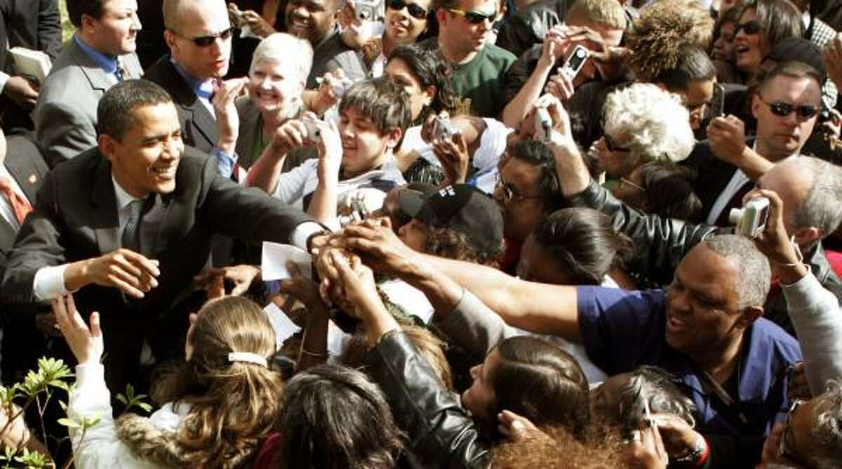 Sen. Barack Obama, D-Ill., wades into a crowd of supporters Thursday in Beaumont.