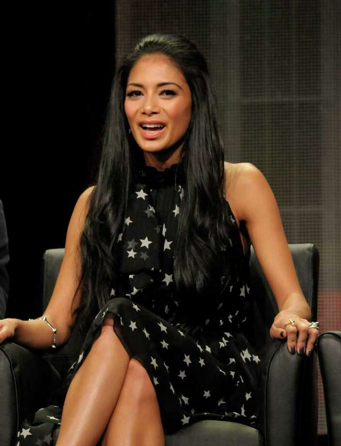 """Singer Nicole Scherzinger speaks during a panel at the The Television Critics Association 2011 Summer Press Tour in Beverly Hills, Calif. on Friday, Aug. 5, 2011. Scherzinger is a judge in the television reality show """"The X Factor"""" on FOX. Photo: AP"""