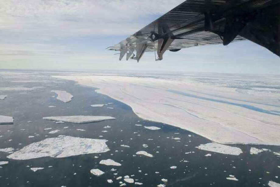 Large pieces of ice drift after breaking off of the Ward Hunt Ice Shelf in July. Scientist are reporting similar incidents all over the Arctic. Photo: SAM SOJA, ASSOCIATED PRESS