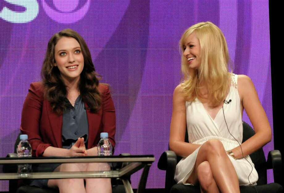 "Actress Kat Dennings, right, and actress Beth Behrs speak during a panel at the The Television Critics Association 2011 Summer Press Tour in Beverly Hills, Calif. on Wednesday, Aug. 3, 2011. Dennings and Behrs star in the television series ""2 Broke Girls"" on CBS. Photo: AP"