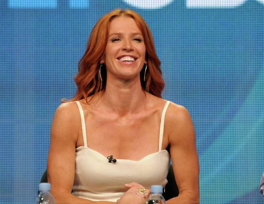"Actress Poppy Montgomery speaks during a panel at the The Television Critics Association 2011 Summer Press Tour in Beverly Hills, Calif. on Wednesday, Aug. 3, 2011. Montgomery stars in the television series ""Unforgettable"" on CBS. Photo: AP"