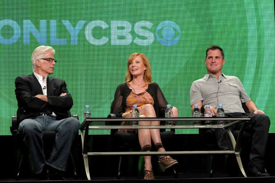 """Actress Marg Helgenberger, center, speaks as actor Ted Danson, left, and actor George Eads speak during a panel at the The Television Critics Association 2011 Summer Press Tour in Beverly Hills, Calif. on Wednesday, Aug. 3, 2011. Danson, Helgenberger, and Eads star in the television series """"CSI: Crime Scene Investigation"""" on CBS. Photo: AP"""