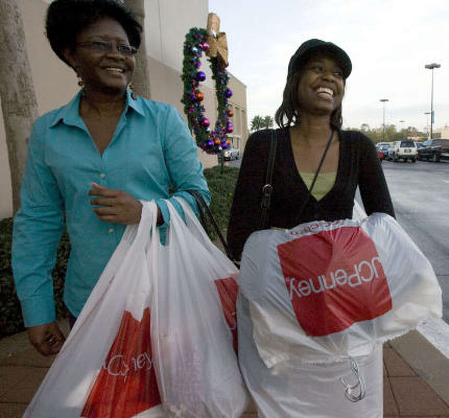 Valerie Bension of Houston (left) and her daughter Stephanie, 20, woke up at 4 a.m. to be shopping by 5 a.m. at the JCPenney in Meyerland Plaza as early morning shoppers rushed for sales on Black Friday. Photo: JOHNNY HANSON, Houston Chronicle