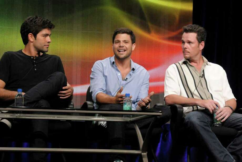 "Actor Jerry Ferrara, center, speaks, while actor Adrian Grenier, left, and actor Kevin Dillon look on at the The Television Critics Association 2011 Summer Press Tour in Beverly Hills, Calif. on Thursday, July 28, 2011. Ferrara, Grenier, and Dillon star in the series ""Entourage"" on HBO. Photo: AP"