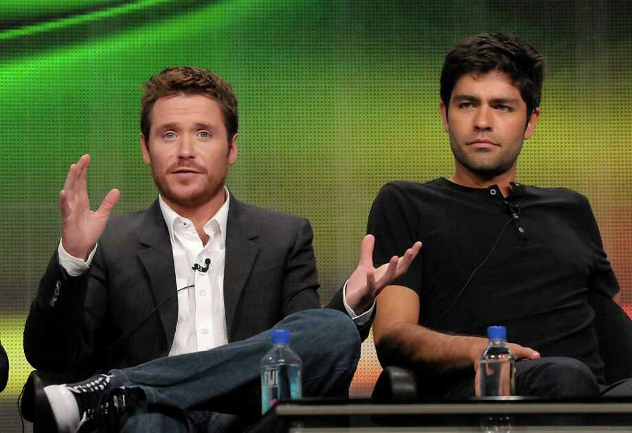 "Actor Kevin Connolly, left, and actor Adrian Grenier speak during The Television Critics Association 2011 Summer Press Tour in Beverly Hills, Calif. on Thursday, July 28, 2011. Grenier and Connolly star in the series ""Entourage"" on HBO. Photo: AP"