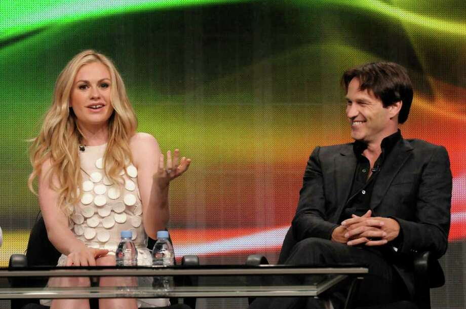 "Actress Anna Paquin, left, and actor Stephen Moyer speak at The Television Critics Association 2011 Summer Press Tour in Beverly Hills, Calif. on Thursday, July 28, 2011. Moyer and Paquin star in the series ""True Blood"" on HBO. Photo: AP"