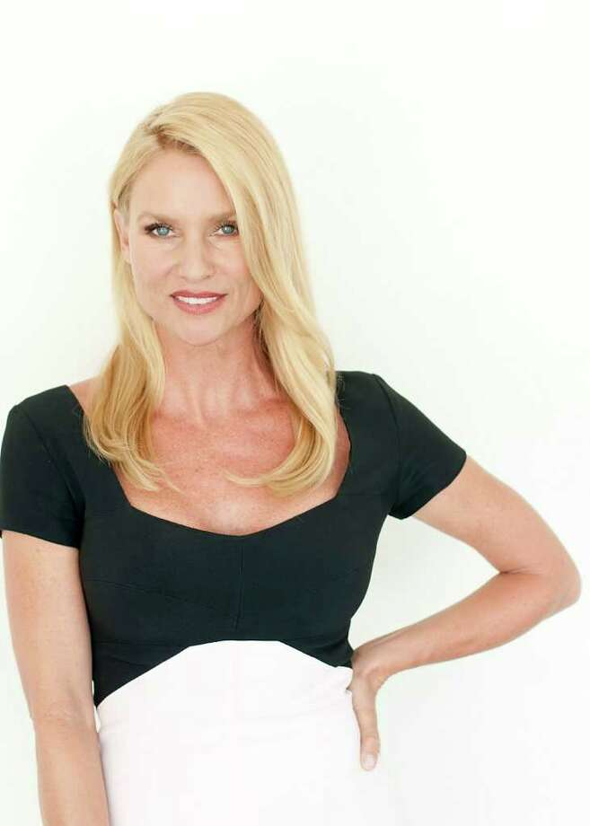 "Actress Nicollette Sheridan poses for a portrait at during The Television Critics Association 2011 Summer Press Tour in Beverly Hills, Calif. on Wednesday, July 27, 2011. Sheridan is starring in the upcoming television movie ""Honeymoon for One"" on the Hallmark Channel. Photo: AP"