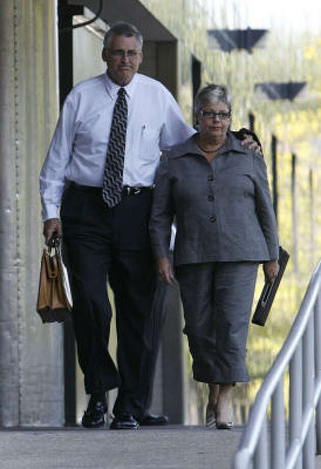 U.S. District Judge Samuel Kent walks out of the Bob Casey Federal Courthouse with his wife, Sarah Kent, Sept. 3 in Houston. Photo: Julio Cortez, Chronicle