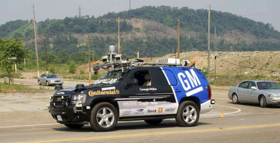 A driverless Chevrolet Tahoe made by GM races in a Pentagon-sponsored competition. Photo: Vincent Zeng, AP File Photo