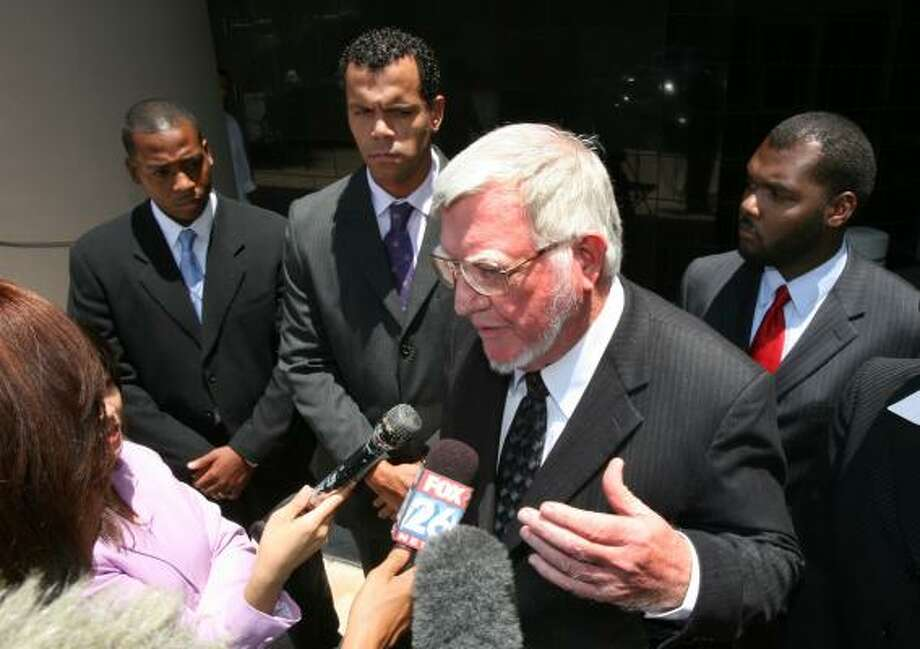 Attorney Patrick Gilpin answers questions during a break at the federal courthouse in downtown Houston Monday. His clients, William Hudson, left, Oliver Brown, center, and Justin Jordan allege in their lawsuit that TSU officials violated their First Amendment rights. Photo: STEVE CAMPBELL, CHRONICLE