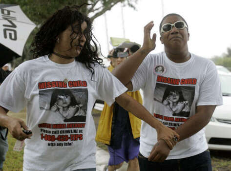 River Allen, left, and Kalani Bowles, who say they are friends of Casey Anthony, are overcome with emotion as they arrive on the scene where the skeletal remains of a child were found in Orlando, Fla., Thursday. Photo: John Raoux, AP